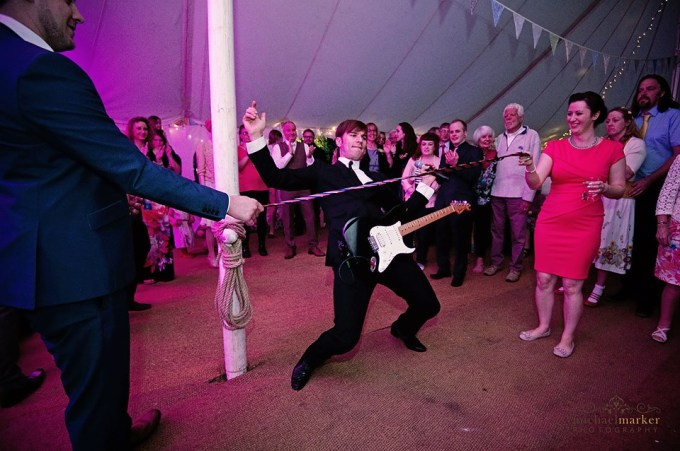 Jamie doing a limbo at the wedding, Wedding band in Wiltshire, Wedding band in Marlborough, Entertaining wedding band, Dan and Tamzin's wedding pictures, For The Zoots, wedding band blog