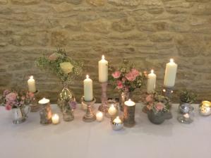 Candles at wedding at Kingscote barn