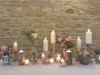 Candles at wedding at Kingscote barn